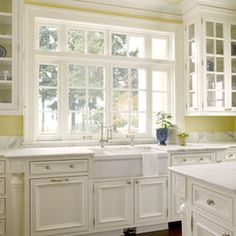 kitchen window, butler's sink, cabinetry painted to match the window trims = country house bliss.
