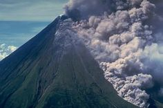 Ash clouds rise above a pyroclastic flow traveling down the Buang valley on the upper NW flank of Mayon volcano in the Philippines on September 12, 1984. The toe of the advancing pyroclastic flow is visible at the lower right. These pyroclastic flows traveled down to 100 m elevation at rates of about 20 m/sec.