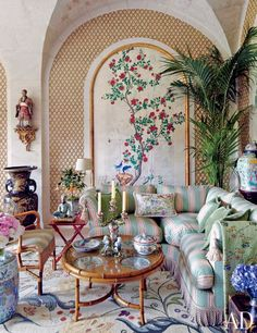 Valentino Garavani's Asian-Inspired Château Near Paris ~ Chinese panels fill the winter garden's arched niches; the cocktail table is inset with famille-rose plates.