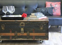 An old trunk turned into a coffee table makes a stylish decor statement for the den or game room and provides extra storage space as well.