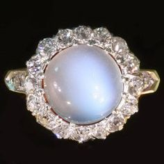 Charming late Victorian engagement ring with moonstone and old mine cut diamonds