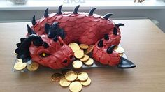 Red Dragon Cake guarding gold coins