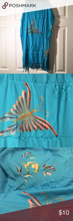Blue Butterfly Sarong Turquoise blue material with embroidery and printed butterflies and flowers. Tasseled edge. Swim Sarongs