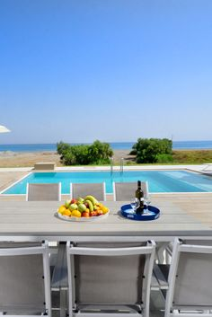 Beach villas are two seafront, modern 4-bedroom villas each with a private pool, only 30 meters away from the lovely mixed sandy and shingle beach of Tavronitis, 25 km west of the picturesque town of Chania.  #crete #greece #chania #summer #vacations #holiday #travel #sea #sun #sand #nature #landscape #island #TheHotelgr