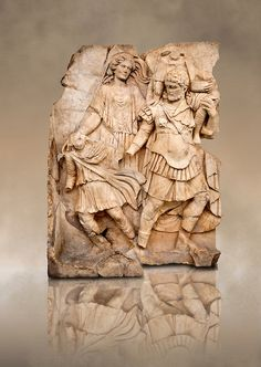 Roman relief sculpture of Aineas Fleeing Troy with his wife & children from the Oda first room, Aphrodisias, Turkey