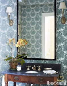 The powder room of a New York colonial features Vaughan sconces, Newport Brass sink fittings, and Farrow & Ball's Lotus wallpaper.Click through for more designer bathrooms and bathroom decor ideas. Bathroom Color Schemes, Bathroom Paint Colors, Paint Tiles, Lotus Wallpaper, Modern Wallpaper, Wallpaper Ideas, Powder Room Decor, Powder Rooms, Best Bathroom Designs