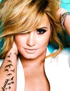 Love her bird tattoo