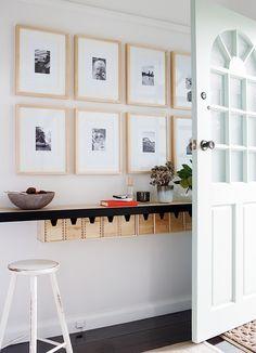 Cute idea for a narrow entryway - I love the hidden storage!