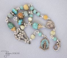 Repurposed Vintage Bracelet, Religious Charms, One of a Kind Designs by JryenDesigns.