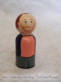 Everyone needs her own Joss.  - Joss Whedon Wooden Peg Doll by ThePaintedParasol on Etsy, $7.00 #VeryWhedonChristmas