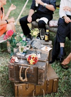stacked vintage suitcases as outdoor casual picnic table