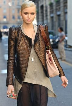 Nice Street look. Love the structured jacket, asymmetrical top, the simple necklace and all those rings.