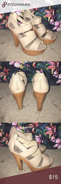 """Charlotte Russe Nude Platform Heels Worn a few times, still in good condition. Faux leather upper and faux wooden heel. 5.5"""" heel with a 1.5"""" platform. Zippered closure at back. They're surprisingly light. Only one small mark on right shoe (pictured), but not even noticeable. No size on shoe, but they are an 8 and true to size. No box. Charlotte Russe Shoes Heels"""