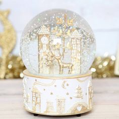christmas wonderland musical snow globe by red berry apple | notonthehighstreet.com