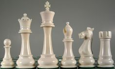 "The Ultimate bone Staunton chess set? These 5"" King chess pieces are hand crafted in camel bone and is a highly desirable set for both chess players and collectors. The opposing 'black' pieces can be stained to a buyer's own color preference and includes red, black, turquoise and green...what's your preference?"