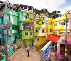 In Brazil, Artists Plan To Brighten Up A Shanty Town With Colorful Murals For artists Haas and Hahn, the shanty towns—or favelas—of Rio de Janeiro have inspired them to create their murals. Santa Marta, Favelas Brazil, The Places Youll Go, Places To Go, Cities, Thinking Day, Dutch Artists, Slums, Architecture