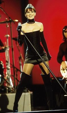 """In one of her most memorable performances to date, Shania brought down the house at the 1999 Grammys with a show-stopping rendition of """"Man, I Feel Like a Woman,"""" sporting sexy short shorts, a corset and thigh-high boots.   Photo © Kevin Mazur/WireImage/Getty Images"""