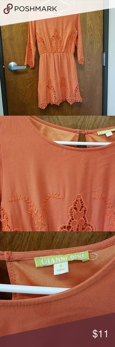 Gianni Bini Dress Orange/rust-ish colored peasant style dress with lace. Long sleeve with a button closure on the back. Tiny snag shown in image 2 and small stain/discoloration at neckline shown in image 3. Overall GUC. Priced accordingly. Gianni Bini Dresses Long Sleeve