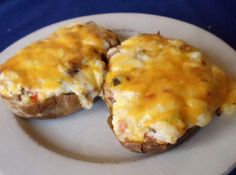 Samantha Jolin's Amazing Twice Baked Potatoes ~ filled with goodies! Her recipe is on justapinch.com!