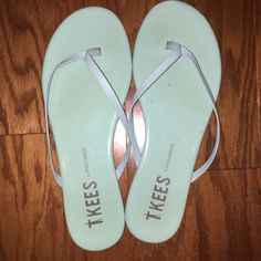 TKees Lipgloss Flip Flops in Mint Green T Kees patent leather sandals in a gorgeous mint green color. My cats got a hold of them once and put a few small wholes in them which are only noticeable up close but I have include a picture of them. Luckily the color is just so perfect that nothing else really matters!! You need this in your summer collection!! Only worn once. T Kees Shoes Sandals