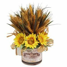 "Silk sunflowers and wheat in a French-inspired vase.  Product: Faux floral arrangementConstruction Material: Silk, plastic and glassColor: Yellow, green, tan and goldFeatures: Includes faux sunflowers and wheatSuitable for indoor use onlyDimensions: 14.5"" H x 11.5"" Diameter"