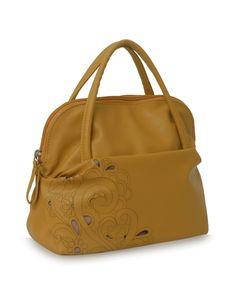 Dreamscape Tarzen mudyellow: A yellow laser cut floral Baggit bag.