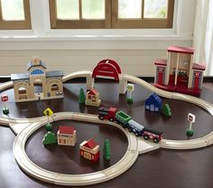 Wooden Train Set from Pottery Barn Kids $59 for 48 pieces (19 tracks). There is also a larger set available.