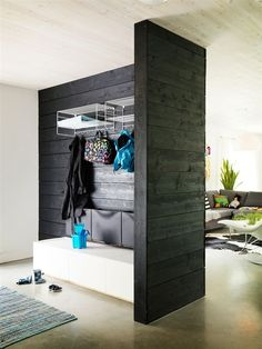 Black & white corner as entryway with Ikea 'Trones' shoe storage cabinets