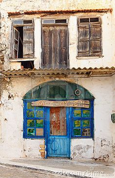 Photo about A derelict cafe bar in Panormo, Crete, with its Greek sign still proclaiming that it was a Cafe-Ouzeri. Image of sign, ruined, greece - 18215340 Crete Island, Greece Travel, Greek Islands, Windows And Doors, Travel Around, Old Photos, Places To See, Countryside, Around The Worlds