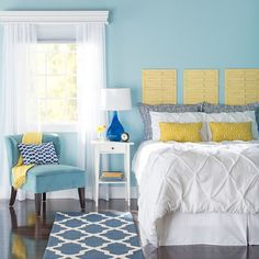 Take your bedroom from boring to blissful with a new color palette. Add light with a bold blue bedside lamp, and layer patterns using accent pillows. Runners on either side of the bed are a budget-friendly alternative to room-size rugs.