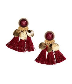 Burgundy. Earrings with a plastic bead, round metal pendants, and decorative…