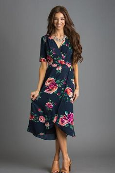 This self-tie wrap dress has the most gorgeous navy floral print! We love any and all wrap dresses, and this one's no exception! The short sleeves and tulip hem makes this a feminine piece you need in