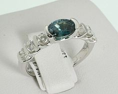 My absolute favorite ring.  Ever.  14K white gold diamond ring with 1.05 oval Alexandrite