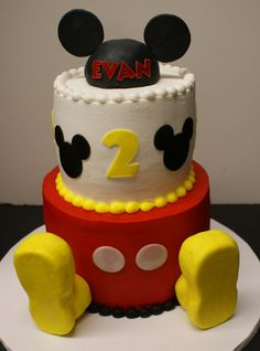 MICKEY MOUSE two tier in butter cream. Hat and feet are rice treats covered with fondant. White buttons, Mickey heads and #2 are cut from Cricut Cake.