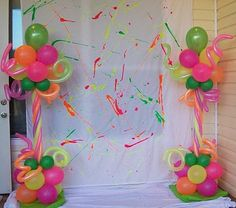 Photo Backdrop with Neon Balloon Columns