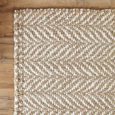 Woven with an oversize herringbone pattern in natural and cream, this rug adds subtle pattern along with texture from the natural fibers.