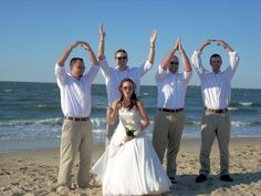 Groomsmen: tan pants with a brown belt, clean white shirt with rolled up sleeves at the elbow