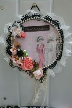 HERES ANOTHER ALTERED CD I CREATED AS A SIGN FOR ELEGANT EMBELLISHMENTS FB GROUP