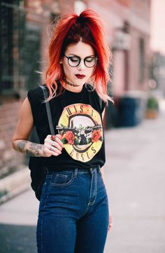 Le Happy wearing high waisted jeans and Guns n Roses tee