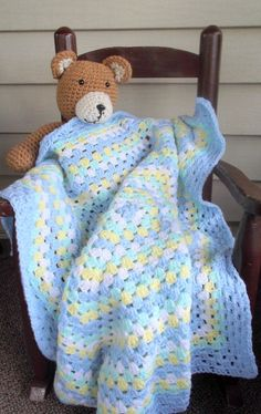 Blue, Green, Yellow, and White Granny Square Baby Blanket