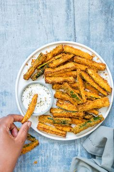 Air Fryer Zucchini Fries are healthy, delicious and soooo quick and easy to make! Crispy and golden, these Parmesan zucchini fries are totally crave worthy.