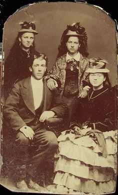 An elegantly dressed group (siblings or cousins?) of Victorian teenagers in (what I'd guess to be) some of their finest for this wonderful studio portrait.