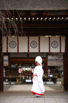 Japanese Bride ... The hood is worn they say to hide the bride's horns of jealousy! She will also change her dress four times throughout the day: first the white uchikake, then a colorful uchikake, a traditional western bridal gown and then an evening gown.