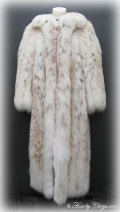SOLD! Ankle Length Christian Dior Russian Lynx Fur Coat #RL600; Very Good Condition; Size range: Misses 8 - 16. This is a dramatic genuine natural Russian lynx fur coat designed by Christian Dior. It has the fabulous subtle markings that Russian lynx is known for and an abundance of white belly fur (the most prized lynx fur). Your purchase will be accompanied by a copy of an appraisal.  This Russian lynx coat is pure luxury with fluffy, long, silky soft fur, and it bears the Dior label!