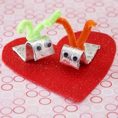 """""""Be My Love Bug"""" Valentine - These cute little """"love bugs"""" are impossible to resist -- add a pair of googly eyes and a pipe cleaner for the antennae to a stick of gum and adhere the creatures to a heart shape to make a fun Valentine's Day gift."""