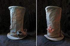 Make a Halloween prop top hat from foam core, aluminum foil, paint and some scrap fabric.