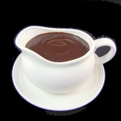 Hot Fudge Sauce  Ingredients:  1-1/2 cups granulated sugar  1/2 cup golden or light brown sugar, packed  3/4 cup dark, unsweetened cocoa  1/4 cup all-purpose flour  1/2 teaspoon salt  1-3/4 cup light cream or half-and-half   1 cup water  2 tablespoons butter  2 teaspoons vanilla extract