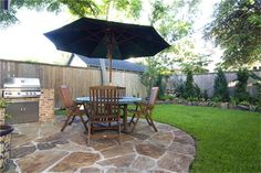 flagstone patio with bulit in grill