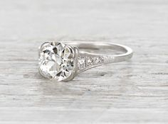 Vintage Art Deco engagement ring made in platinum and centered with an approximately 1.77 carat EGL certified old European cut diamond with H-I color and SI3 clarity. Circa 1920. Don't be too mesmeriz