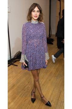 Alexa Chung in a floral dress at London Fashion Week